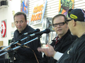 Dennis Diken (center) onstage with the Smithereens